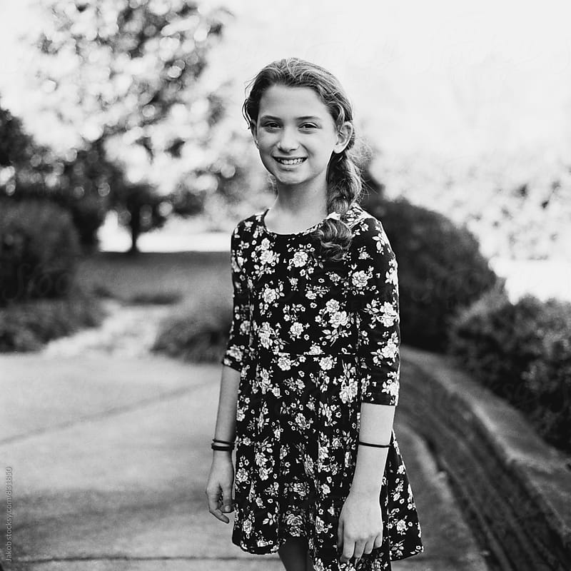 Black and white portrait of a beautiful young girl in a dress by Jakob for Stocksy United