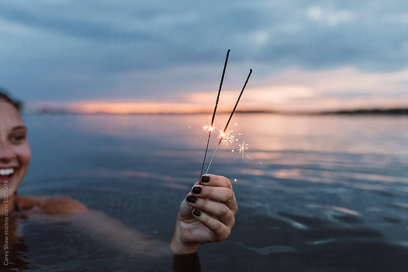 Sparklers against beautiful sunset landscape by Carey Shaw for Stocksy United