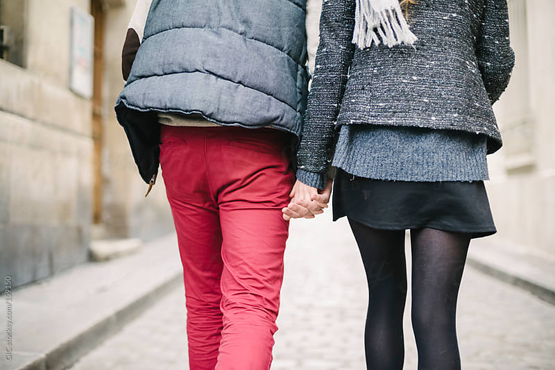 Young couple walking hand in hand in the city by GIC for Stocksy United