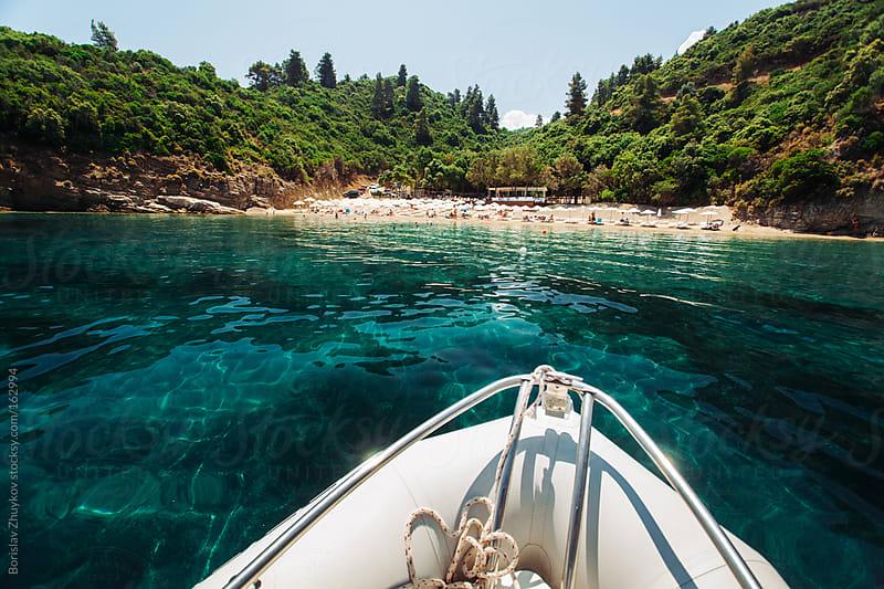 Boat Approaching  Shore of Summer Laguna Beach by Borislav Zhuykov for Stocksy United