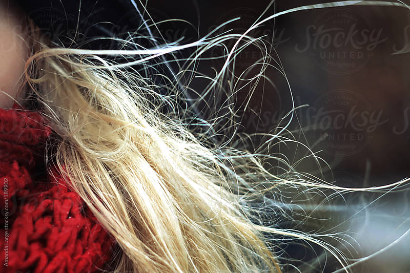 Girl with blonde hair blowing in the wind by Amanda Large for Stocksy United