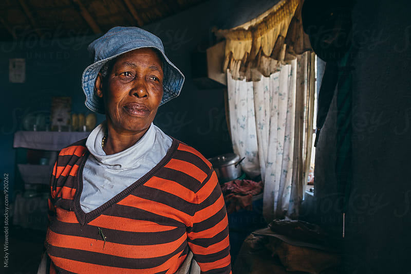 portrait of a Basotho woman in her home by Micky Wiswedel for Stocksy United