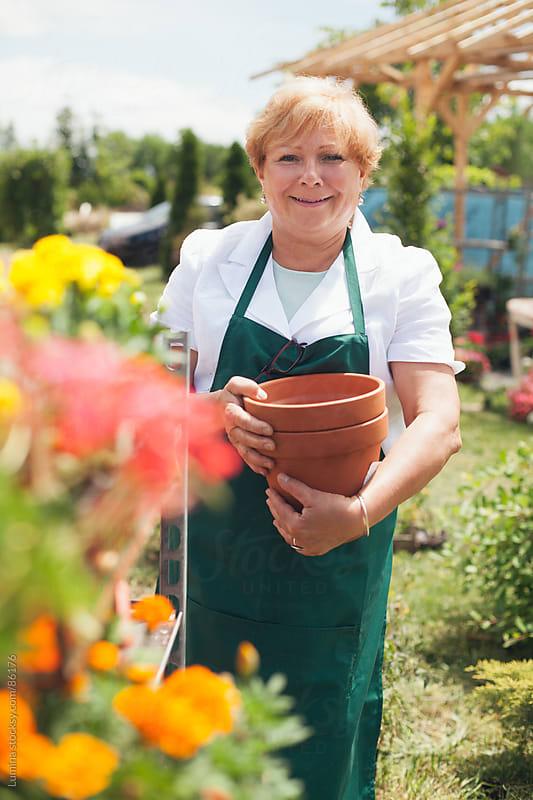 Florist Holding Flower Pots by Lumina for Stocksy United