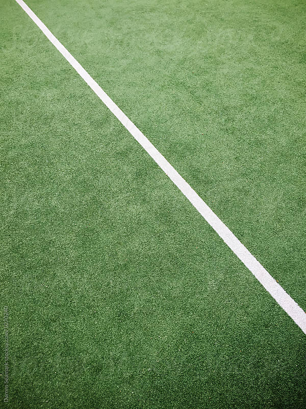 White line on an artifical grass surface by Darren Seamark for Stocksy United