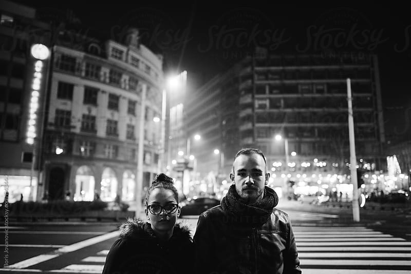 Portrait of couple standing on the street  by Boris Jovanovic for Stocksy United