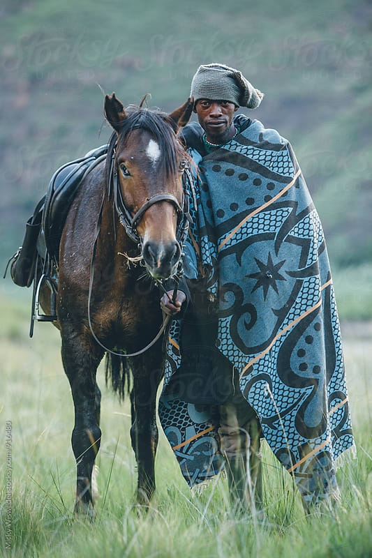 African Basotho herdsman with horse by Micky Wiswedel for Stocksy United