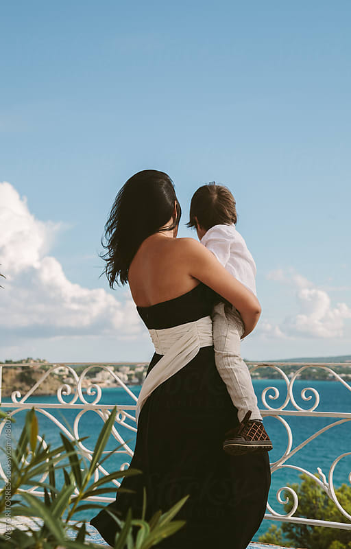 Mother and Child Looking at Seaviews by VICTOR TORRES for Stocksy United
