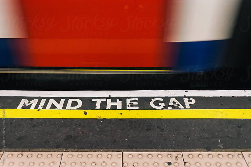 Mind the Gap sign by Mauro Grigollo for Stocksy United