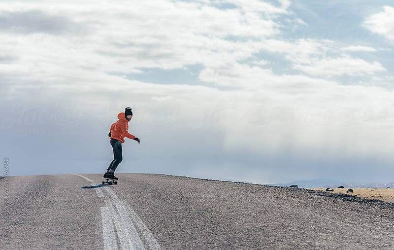 Man skateboarding on the road in Iceland by Soren Egeberg for Stocksy United