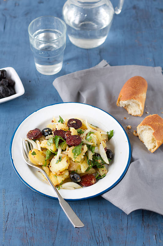 Potato salad with chorizo and black olives by Noemi Hauser for Stocksy United