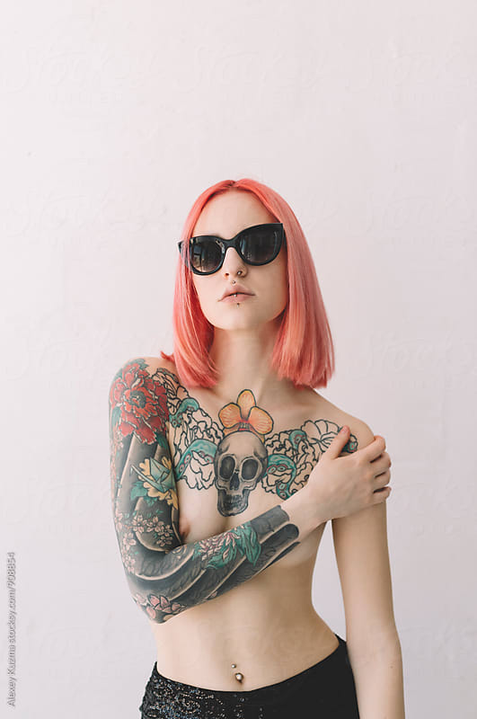 Topless young woman with pink hair by Alexey Kuzma for Stocksy United