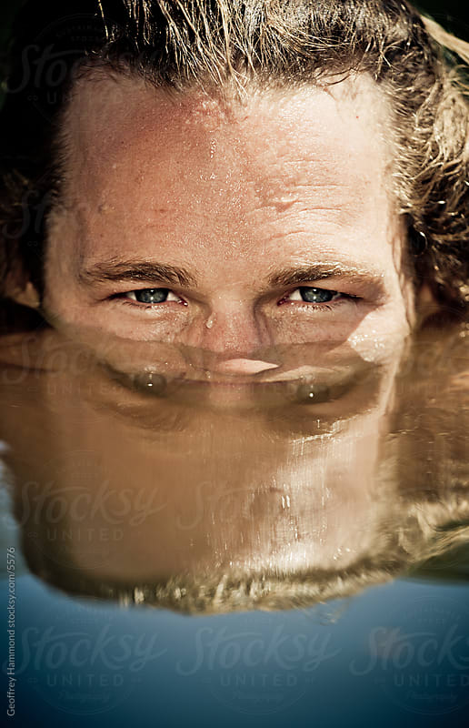 Man Peering Above Water, Close up by Geoffrey Hammond for Stocksy United