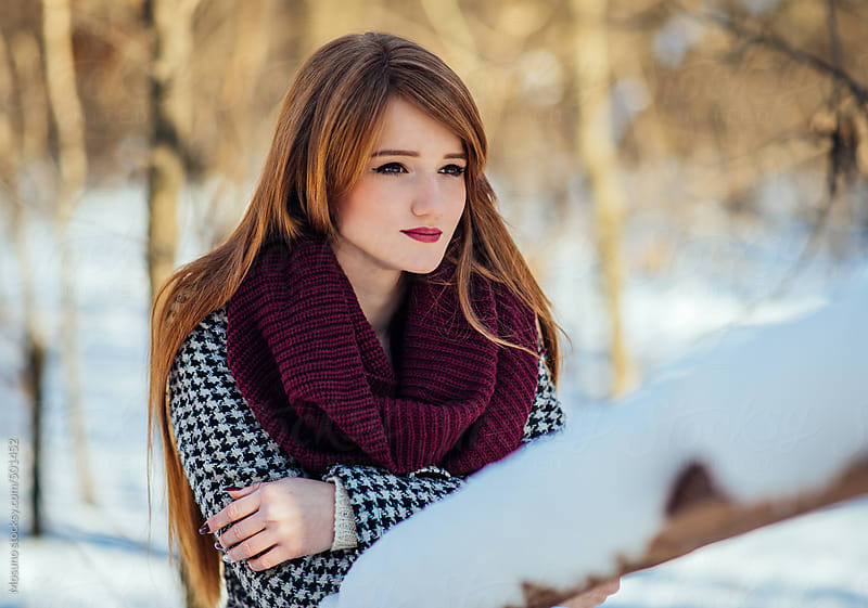 Beautiful Ginger Woman Standing in a Snowy Park  by Mosuno for Stocksy United