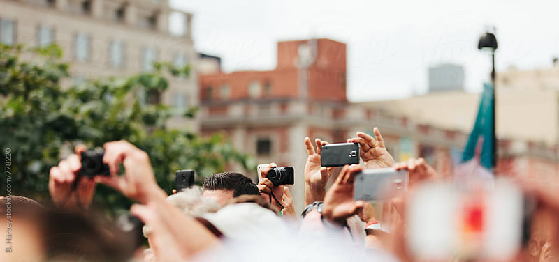 Crowd Shooting Photos on Street by B. Harvey for Stocksy United