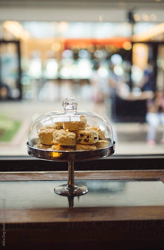 Scones on cake stand in a cafe by Alita Ong for Stocksy United
