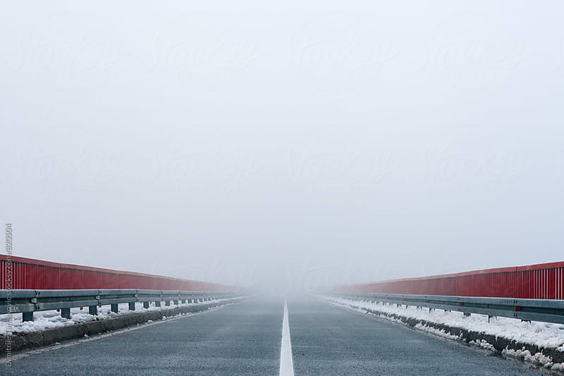 Winter road. Heavy fog over the bridge by Dimitrije Tanaskovic for Stocksy United