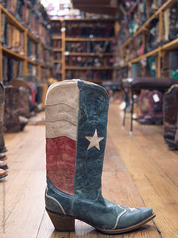 Texas flag leather cowboy boot in southern store by Jeremy Pawlowski for Stocksy United