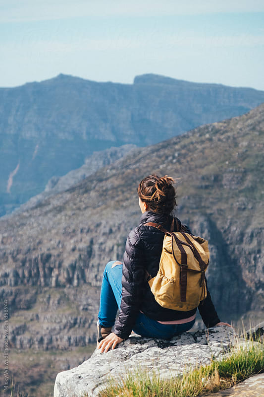 Female hiker with backpack on a mountain summit by Micky Wiswedel for Stocksy United
