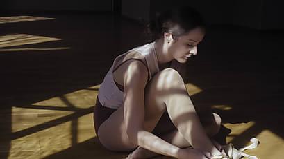 The Ballerina Doing Exercise Stretching On FloorStocksy AL3j54R