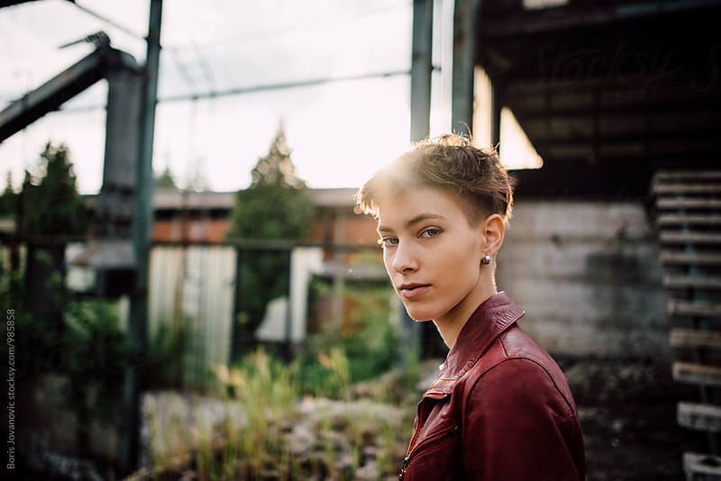 Portrait of beautiful shorthair woman in the abandoned factory by Boris Jovanovic for Stocksy United