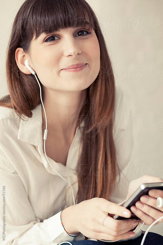 Woman with headphones and smartphone. by W2 Photography for Stocksy United