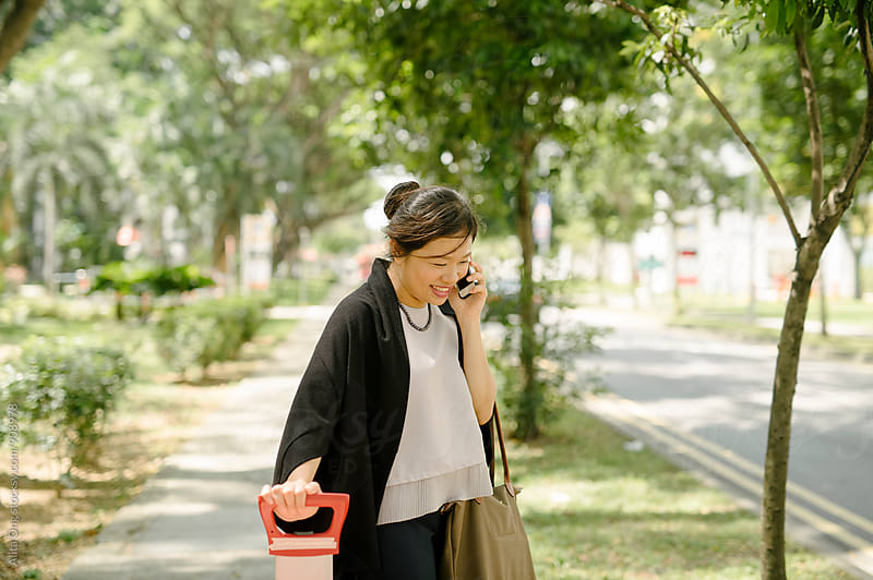 Businesswoman on the road by Alita Ong for Stocksy United