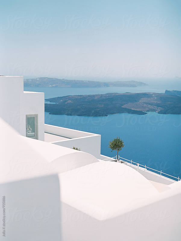 Geometry of traditional Greek buildings on Santorini island by Julia K for Stocksy United