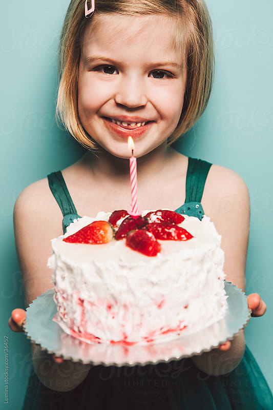 Girl Holding Birthday Cake by Lumina for Stocksy United