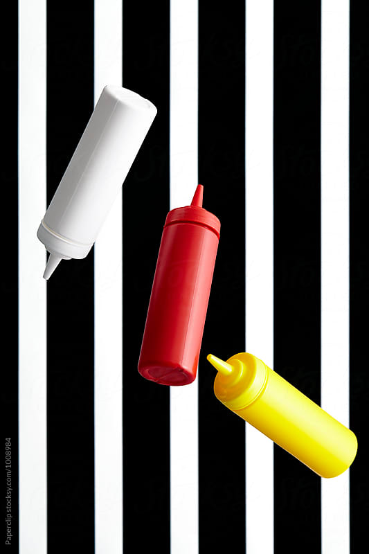 Ketchup-Mustard-Mayonnaise bottles by Paperclip Images for Stocksy United