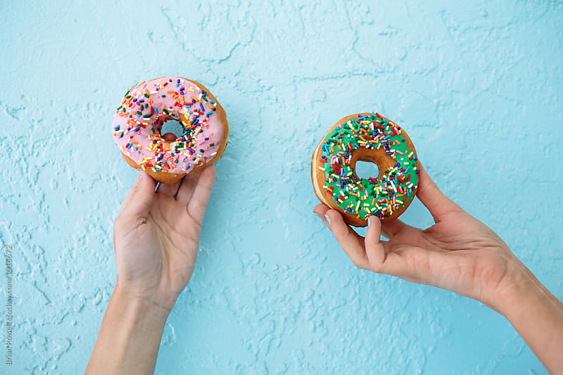 donuts with sprinkles by Brian Powell for Stocksy United