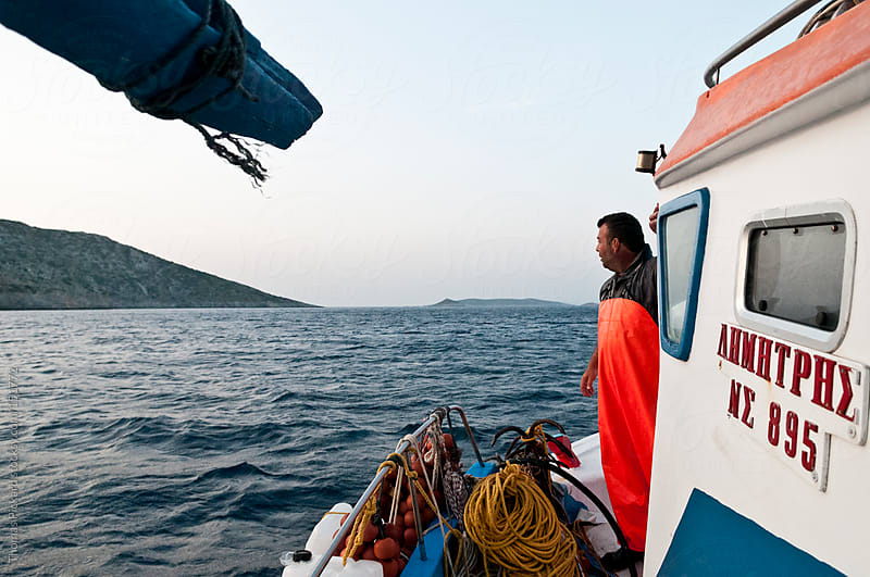 Commercial fisherman looking out over the sea, Fourni Islands, A by Thomas Pickard for Stocksy United