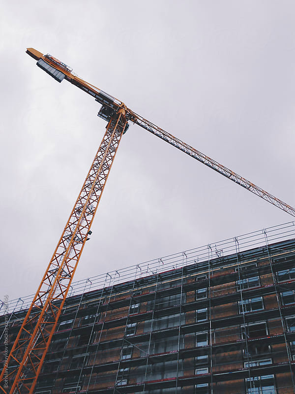 Crane Of Construction Site  by Borislav Zhuykov for Stocksy United