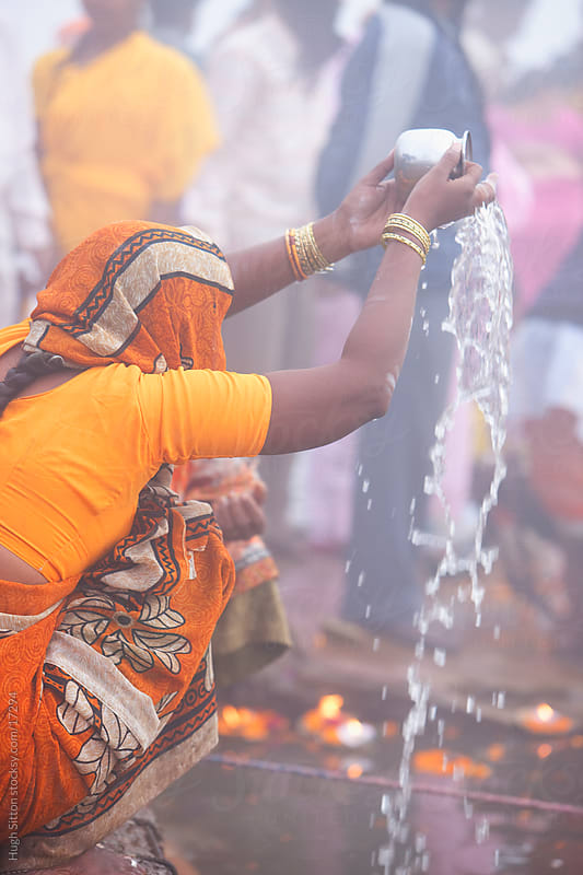 woman in prayer at the River Ganges. Varanasi. India by Hugh Sitton for Stocksy United