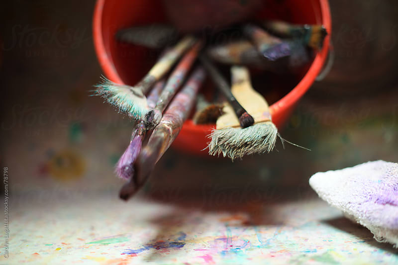 Paint brushes in a bucket in the sink by Carolyn Lagattuta for Stocksy United