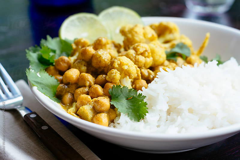 Curried Cauliflower and Chickpeas with Rice by Harald Walker for Stocksy United