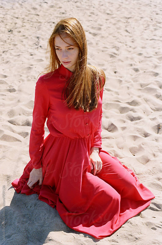 Young woman wearing red dress by Liubov Burakova for Stocksy United