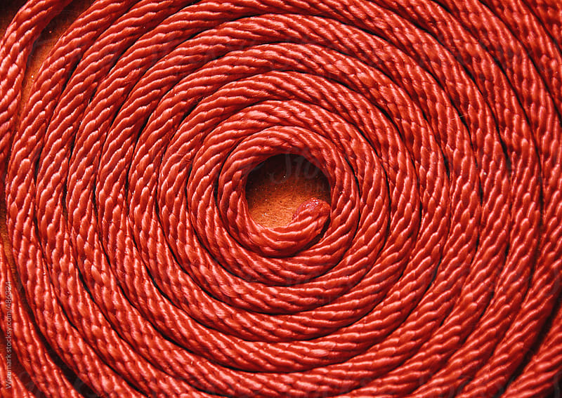 Red rope folded in spiral  by Wizemark for Stocksy United