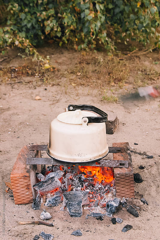Kettle on bofire by Danil Nevsky for Stocksy United