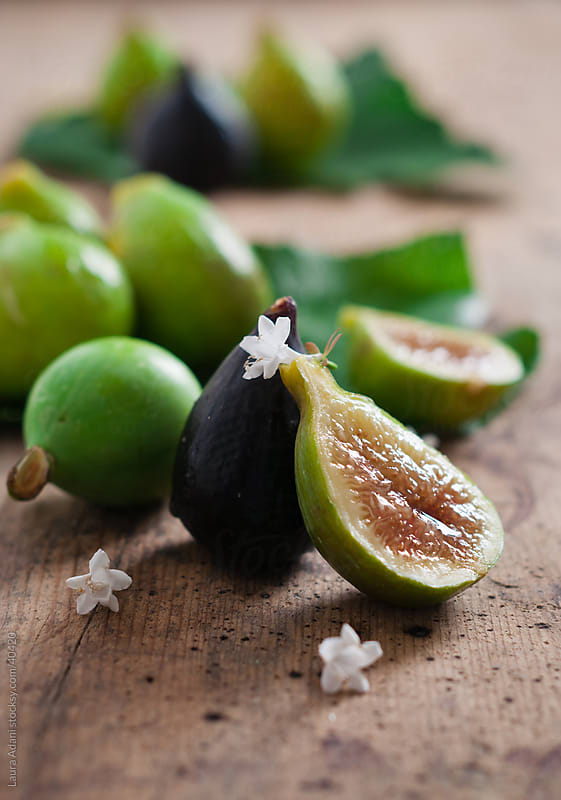 figs and small flowers by Laura Adani for Stocksy United