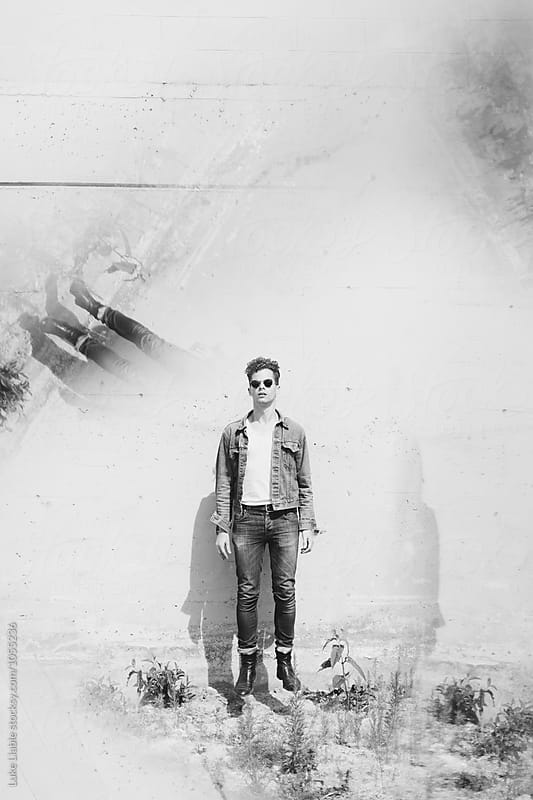 Stylish man in parking lot by Luke Liable for Stocksy United