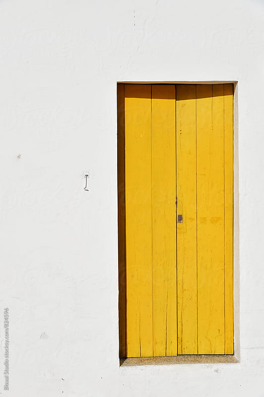 Yellow door by Bisual Studio for Stocksy United