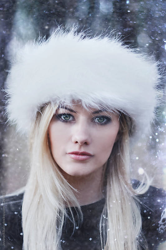 Portrait of a beautiful young girl in snow by Jovana Rikalo for Stocksy United