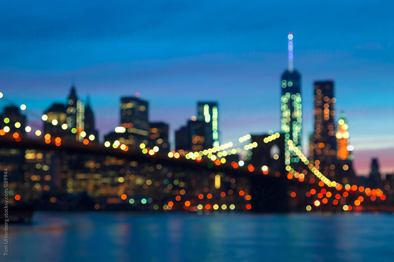 New York City - Defocused Lights of the Brooklyn Bridge and Lower Manhattan Skyline by Tom Uhlenberg for Stocksy United
