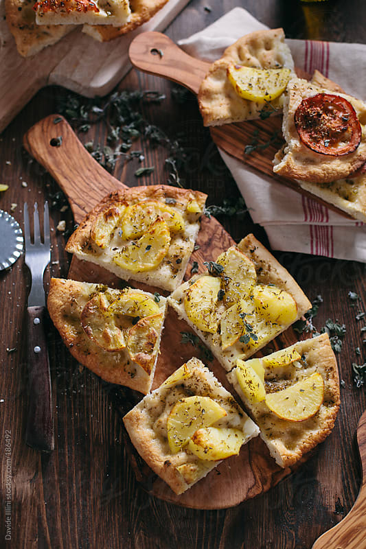 Italian Focaccia with potatoes by Davide Illini for Stocksy United