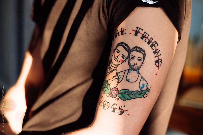 Gay tattoo on man arm by Susana Ramírez for Stocksy United
