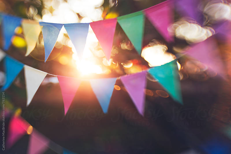 Colourful paper bunting with bokeh and sun flare... by Catherine MacBride for Stocksy United