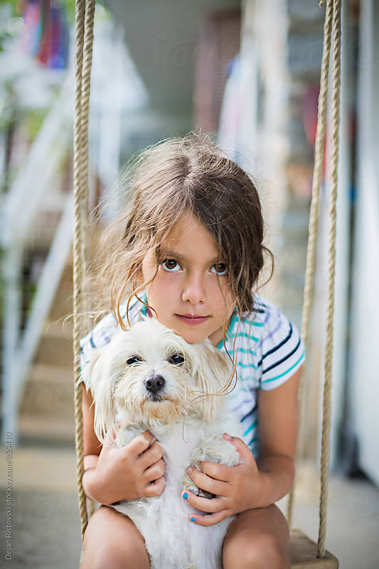 Portrait of a girl and a dog. by Dejan Ristovski for Stocksy United