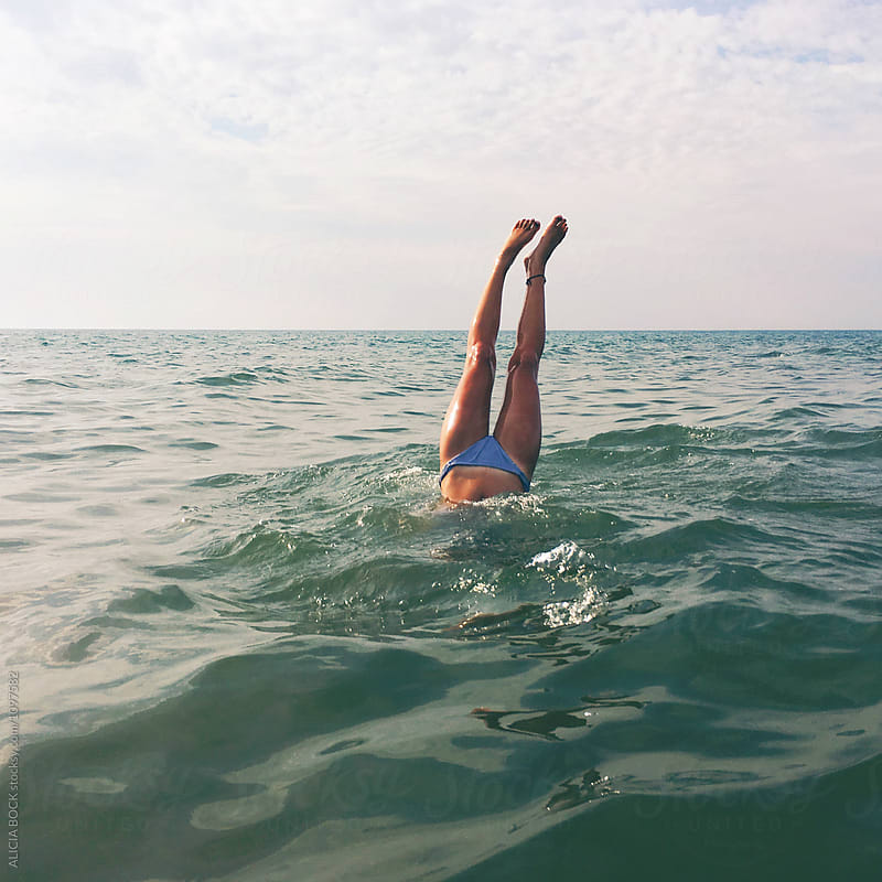 Woman's Legs While In A Handstand In The Sea by ALICIA BOCK for Stocksy United