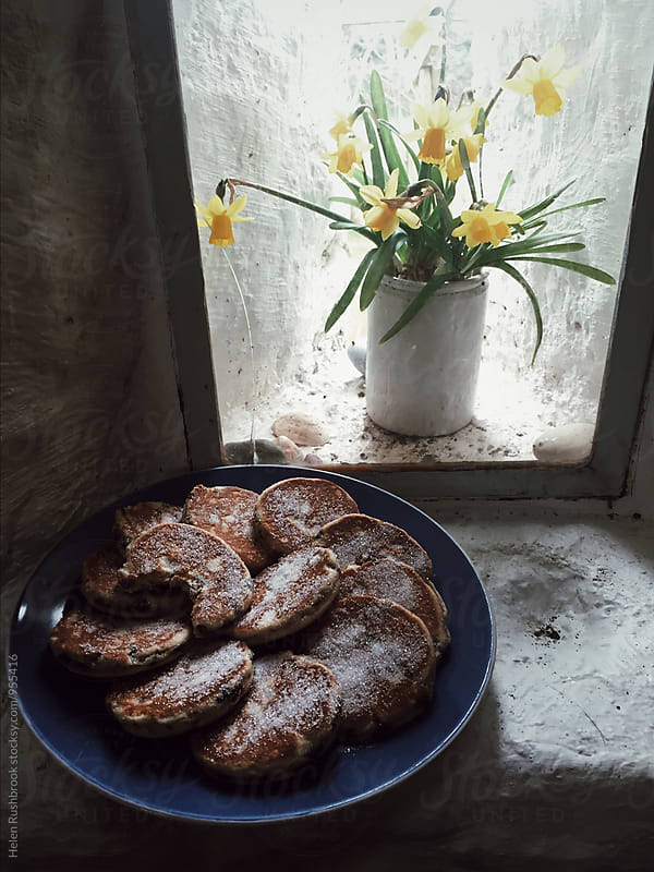 Welshcakes and Daffodils. by Helen Rushbrook for Stocksy United