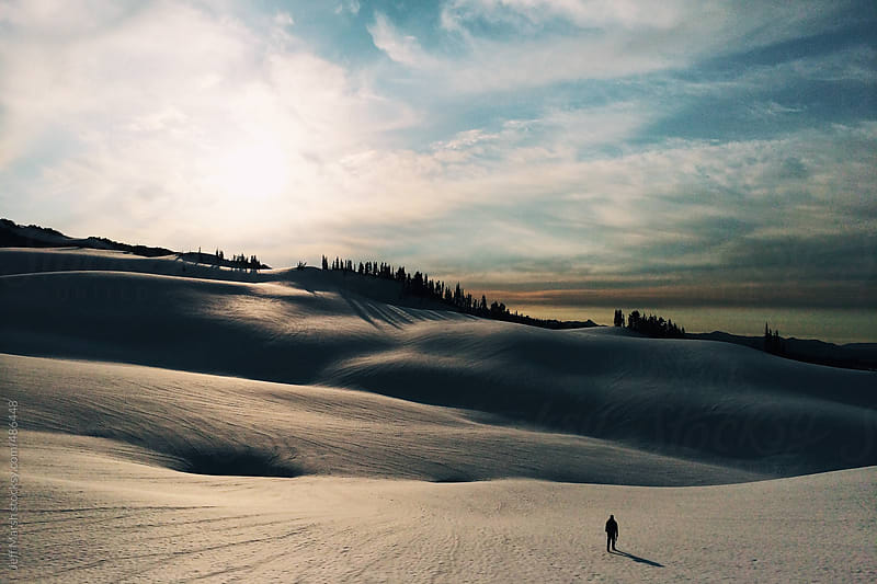 Walking on snow by Jeff Marsh for Stocksy United